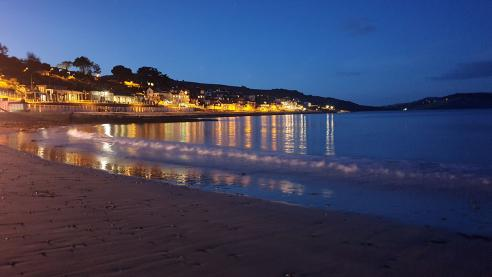 Night falls Lyme Regis beach