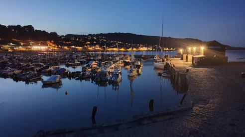Night falls Lyme Regis harbour