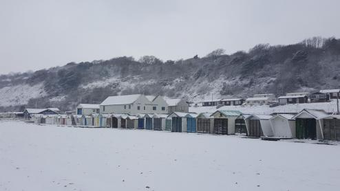 Snow, beach huts Monmouth beach 2018