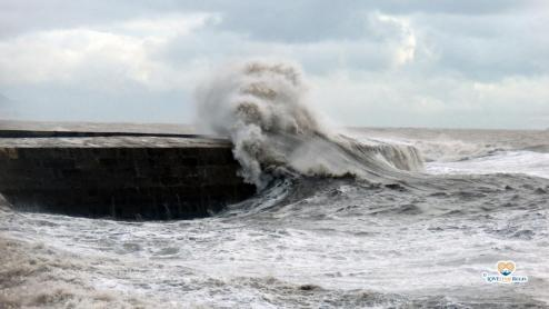 Waves breaking over the side of the Cobb